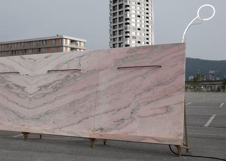 Bureau a installs pink marble urinal at zurich carpark public