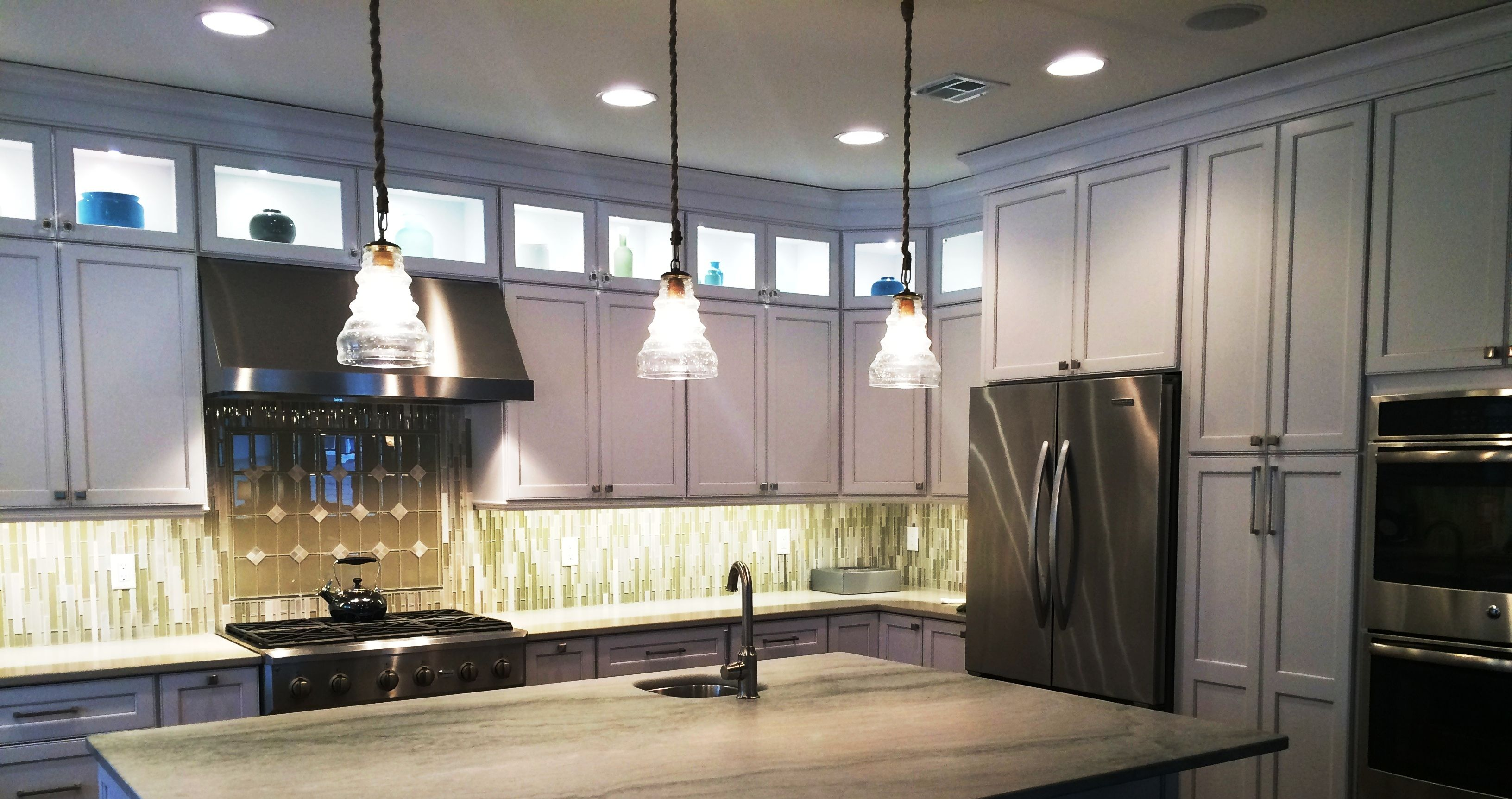 apron cabinets beach blue glass stainless hamptons this yet shaped island l pin kitchens traditional countertops tiles subway steel kitchen is front marble sink white clean the backsplash quintessential in