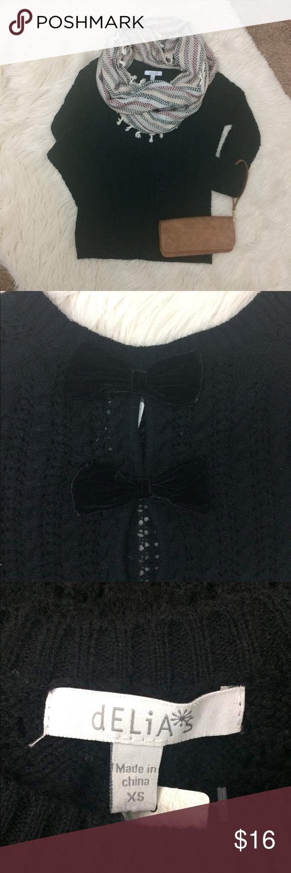 """Knit black sweater with bows in the back W14 Delias size XS open Knit Crewneck long sleeve sweater with velvet bows in the back. No flaws! 17"""" armpit to armpit 24"""" shoulder to hem. delias Sweaters Crew & Scoop Necks"""