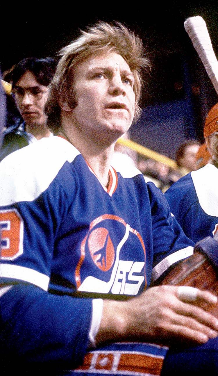 """Robert Marvin """"Bobby"""" Hull on the WHA Winnipeg Jets remains focused, even on the bench."""