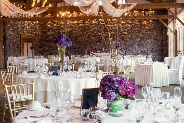 Purple hydrangeas on table tops in the reception hall at La Massaria at Bella Vista in Gilbertsville, Pa
