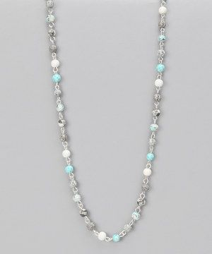 Decorate the décolletage with a true work of art: a stunning handmade necklace. Polymer clay is expertly layered to create each beautiful bead, which helps give this accessory its elegant look.