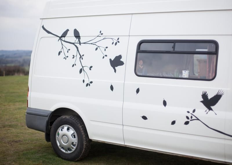Beautiful campervan exterior simply done with vinyl stickers which can be bought online easily applied with soapy water can be removed otherwise will