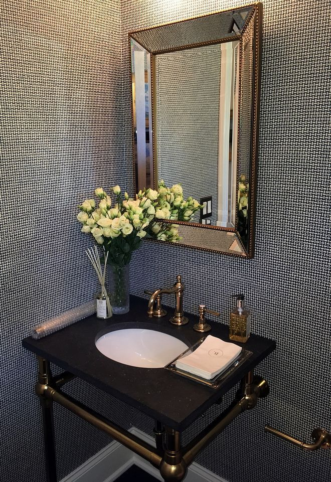 Powder room with textured wallpaper and silver bea... -