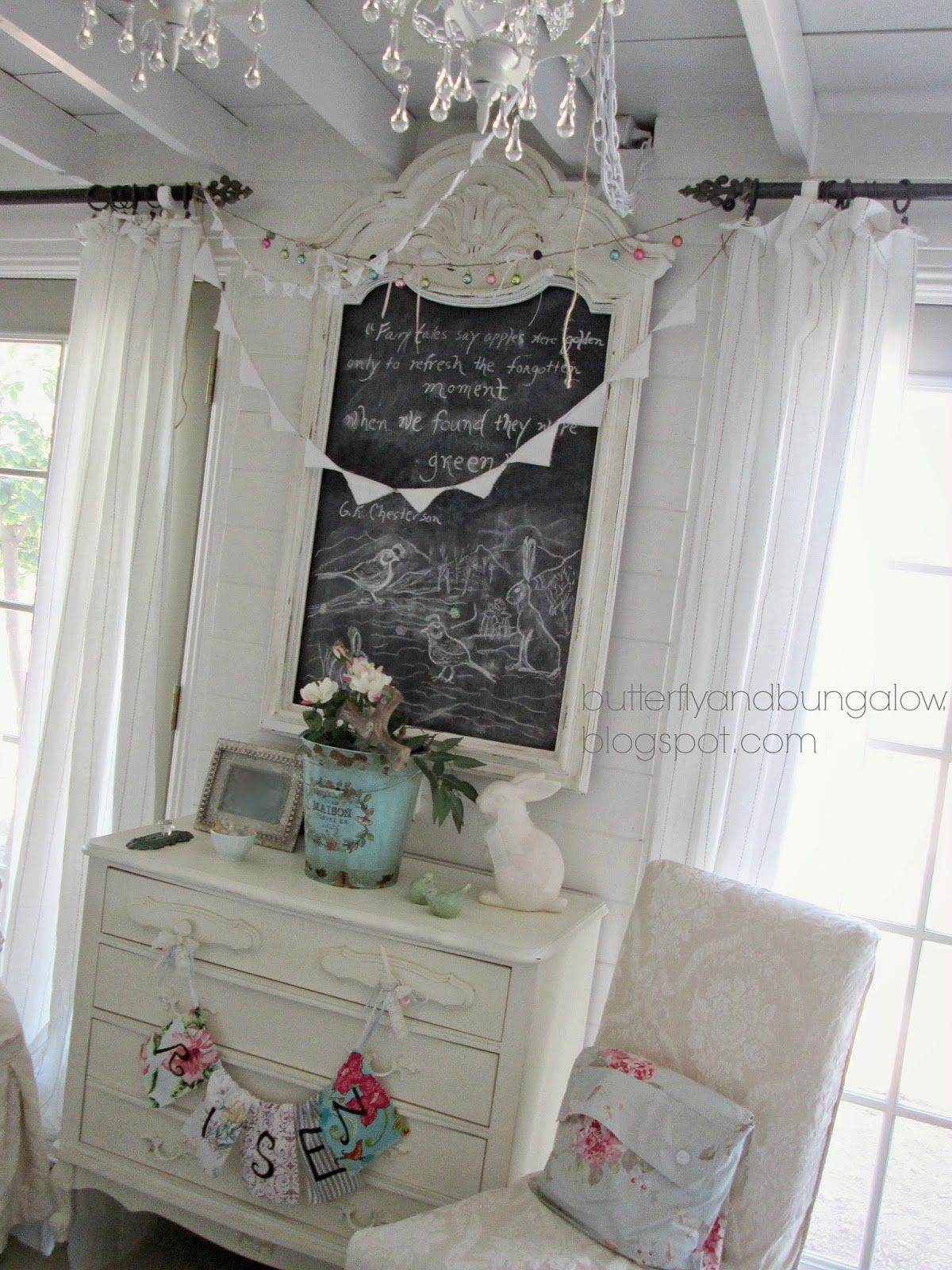 Pretty white dresser embellished with pale blues, rose and white decor.  butterfly 8)(8 bungalow