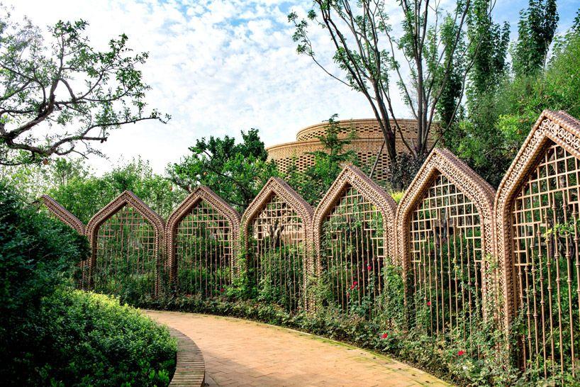 D+H annular brick urumqi garden adorned with local chinese flora - chinesischer garten brucke