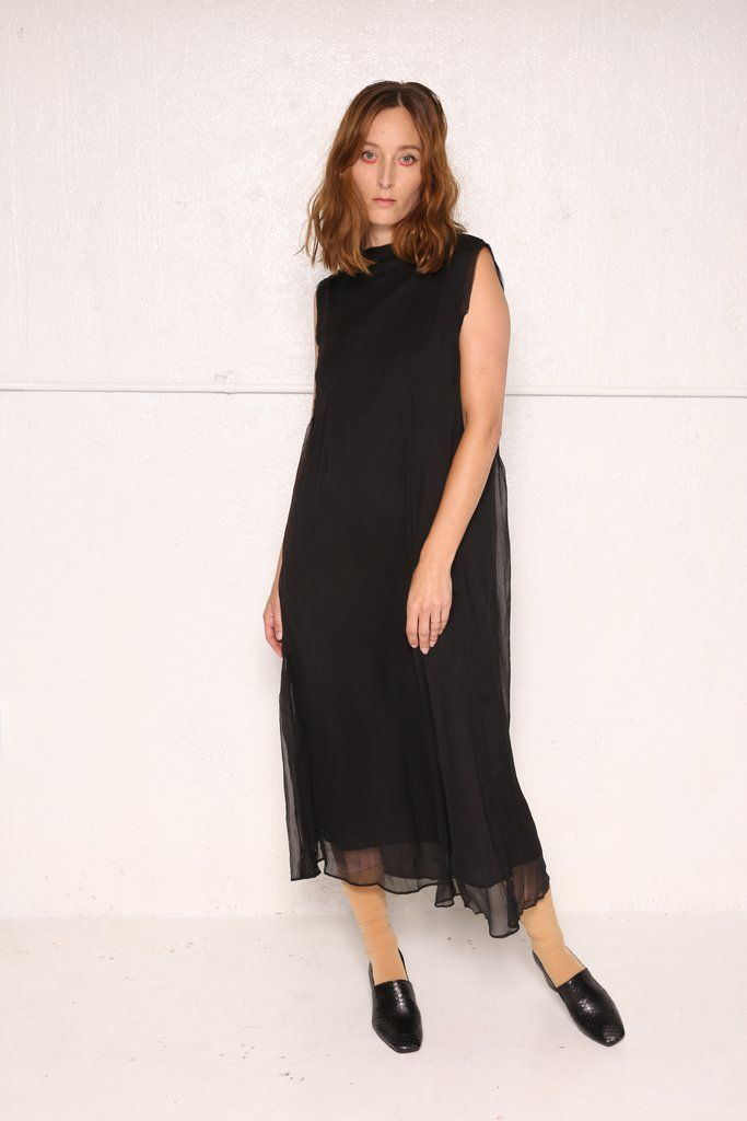 The Choir dress is a layered, versatile and open, toss on sheer dress with a solid under lining. The textured top layers overlap, starting at the shoulder, and
