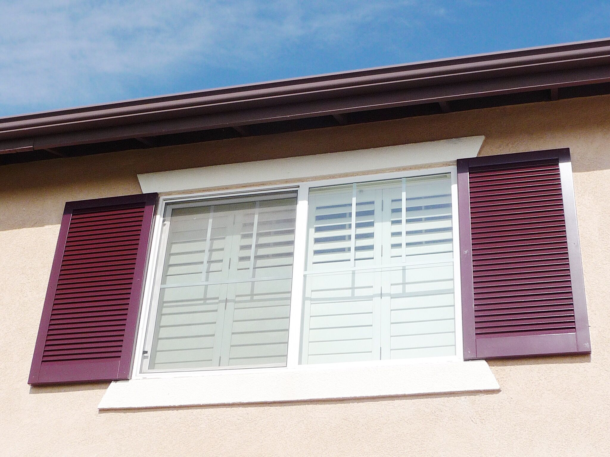Check out these louvered, composite Exterior Shutters we installed ...