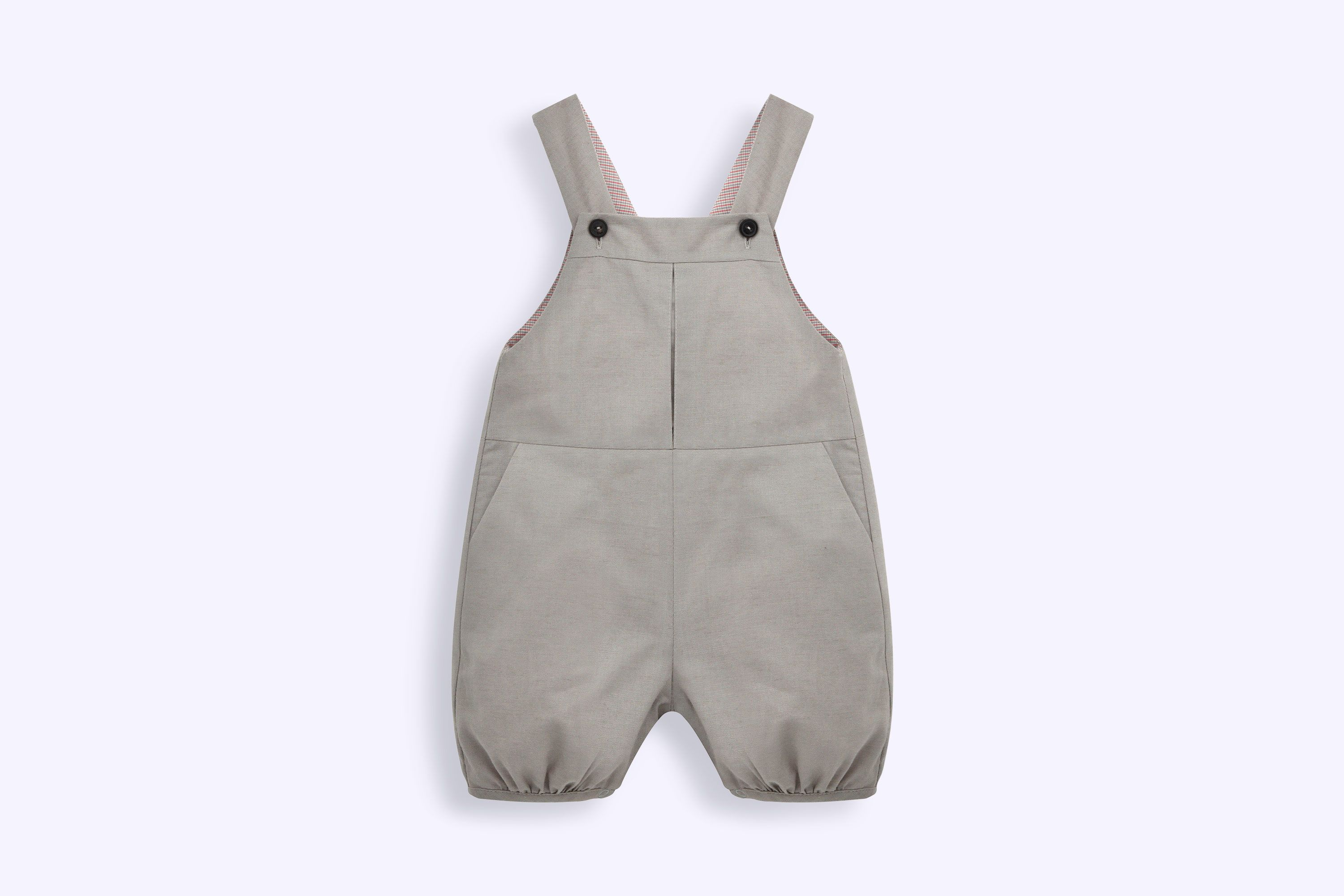 2c10514bfc13 Baby Dior Boy in grey overalls