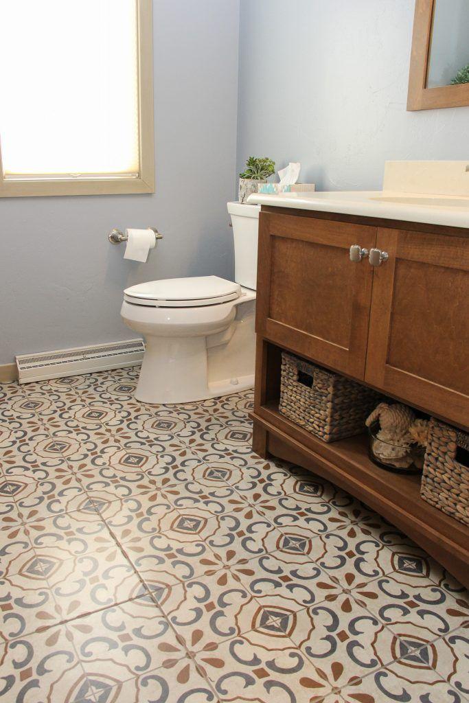 blue and orange pattern tile flooring  orange bathrooms