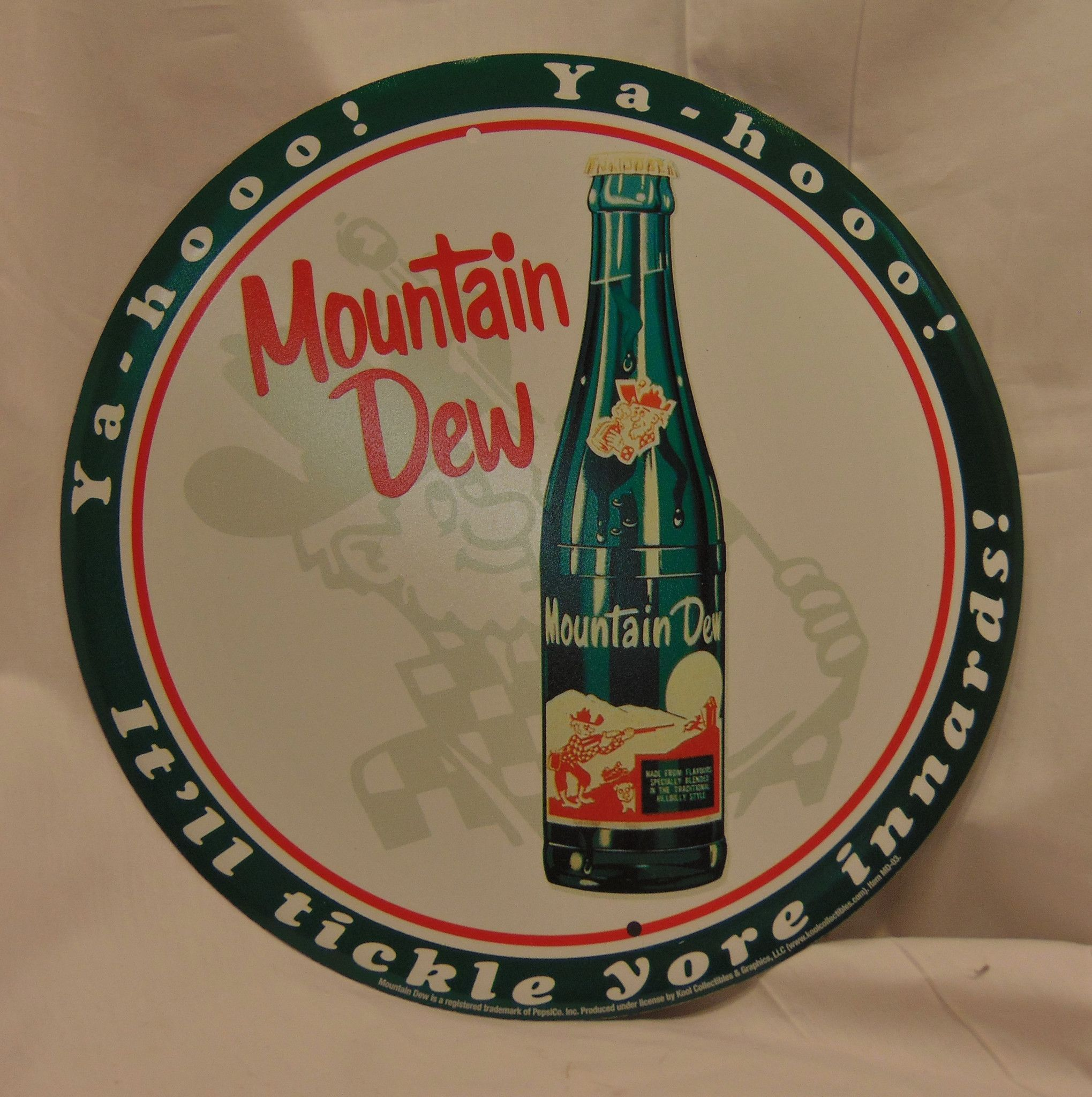 "Mountain Dew Tin Reproduction Advertising Sign Great for a Country or Farm-style Chic home or kitchen project! - Very sturdy tin with rusty brown edges and nice detail. - Measures 12"" across. - Holes"