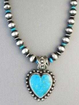 Beautiful Kingman Turquoise Heart Necklace by Native American artist, Happy Piaso from Southwest Silver Gallery.com http://www.southwestsilvergallery.com/AWSCategories/p/412/Heart-Pendants