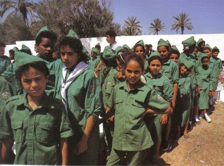 A group of Libyan Girl Guides, like the Young Pioneers in East Germany, their motto was 'Wa A'eddou' - ' Be Prepared .'