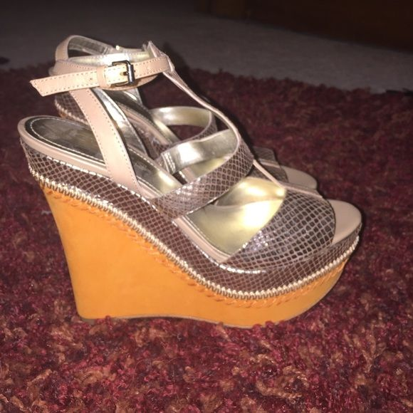 Guess wedges Only worn once for my graduation night! But they're cute for summer!! Guess Shoes Wedges