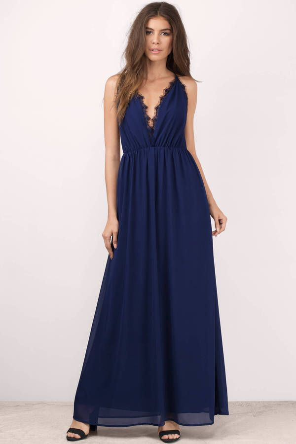 b1b5dcb0cf Navy maxi dress with a plunging neckline and lace trim. Pair with heels and  statement jewelry.