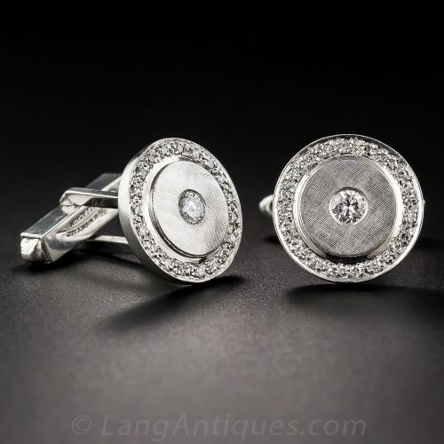 Cool and collectible cuff links, crafted circa 1940s-50s, by famed Swiss watchmakers - Lucien Piccard, during a brief mid-century foray into fine jewelry. Palladium, a member of the platinum family, was used during the WWII years when platinum was required as a strategic metal. These cuff links measure 11/16 inch across, with a sparkling round brilliant-cut diamond, in a finely textured circle bordered by single-cut diamonds. Signed on the swivel backs. .90 carat total diamond weight.