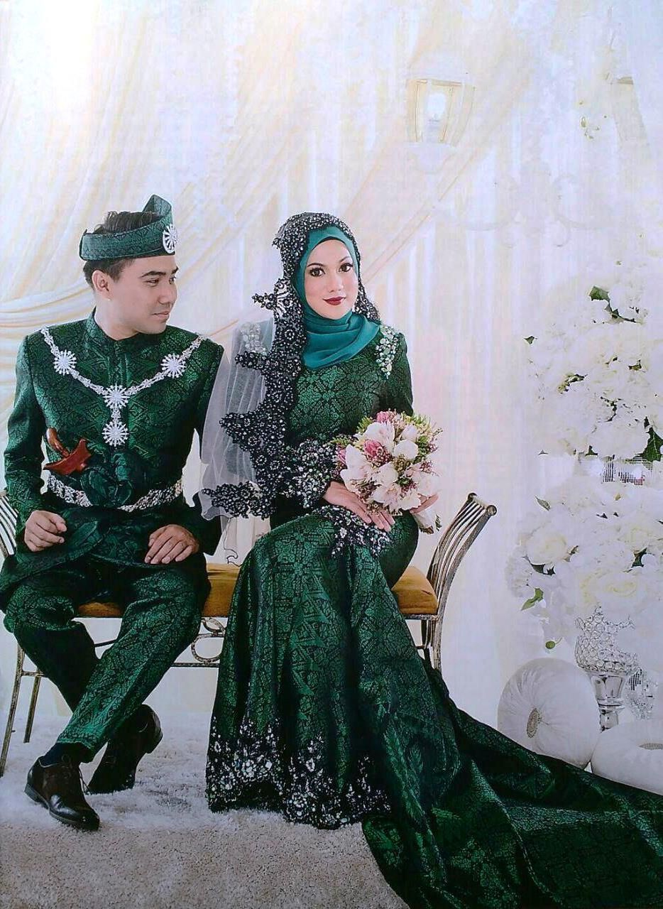 Perfect couple in Emerald Green bride & groom wedding dress