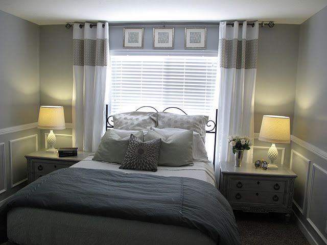 Bed In Front Of Window With Bedside Tables On Each Side
