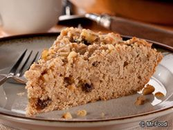 Apea Cake  2 cups all-purpose flour  3/4 cup firmly packed light brown sugar  1 1/2 teaspoons baking powder  1/2 teaspoon ground cinnamon  1/2 cup (1 stick) cold butter, cut into 12 pieces  1/3 cup raisins  1/3 cup chopped walnuts  1 egg  1 teaspoon vanilla extract  1/3 to 1/2 cup milk