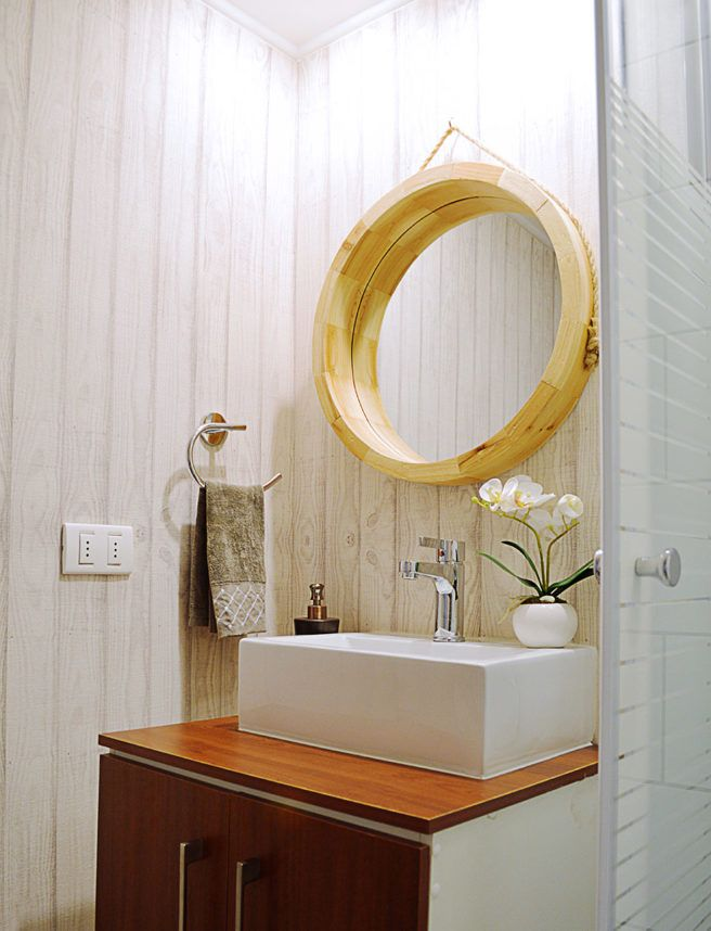 Wallpaper at a modern industrial style bathroom