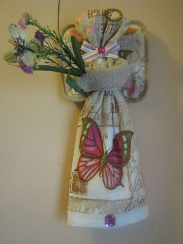Pretty as a picture this kitchen towel angel is.   She even has a butterfly in her bouquet.   She makes a great gift