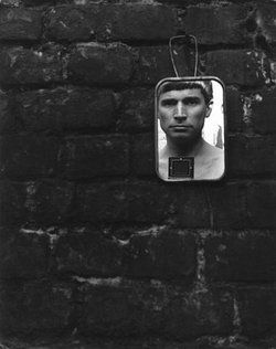 Roger Catherineau, Untitled (self portrait in small hanging mirror), c. 1953