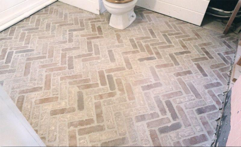 The Walls Are White And More Cottage House Flip Episode 7 Brick Flooring Brick Bathroom Brick Tiles Bathroom