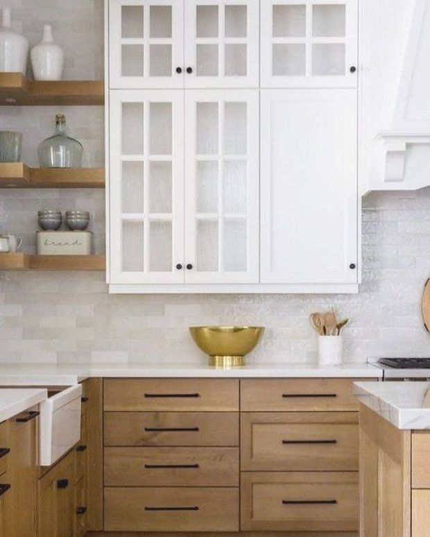 Blond oak wood kitchen with marble countertops and simple ...