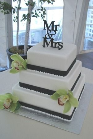Simple square wedding cake with apple green orchids and a \'Mr. & Mrs ...