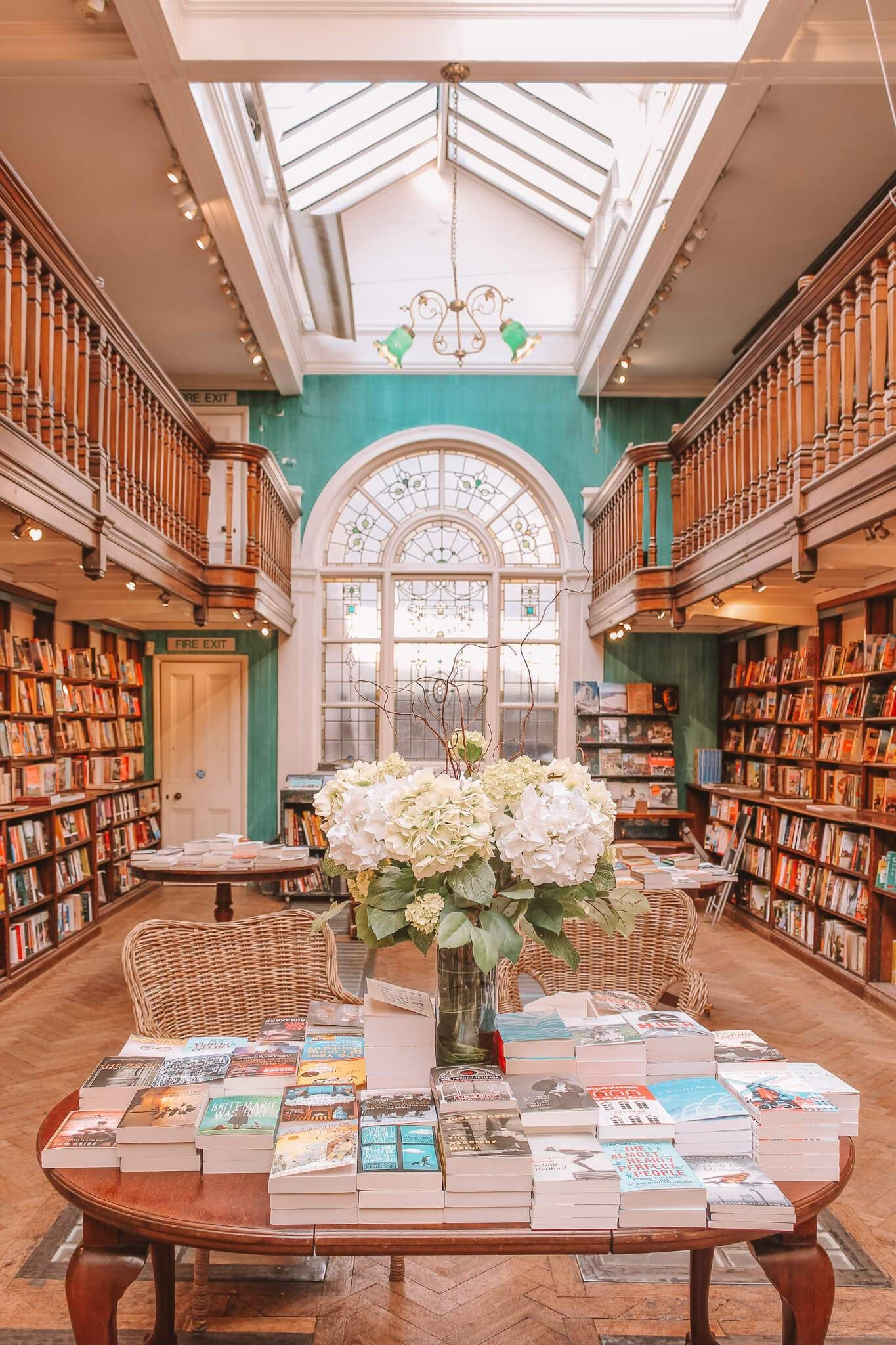 Daunt Books, Marylebone. These are 15 of the most beautiful bookshops in London. London is home to some of the most beautiful bookshops in the world. These are all independent bookshops in London and they stock a variety of old and new, fiction and non-fiction etc. Perfect for bookworms in London! #whatshotblog #bookshopporn #bookstagram #bookshops #travelLondon