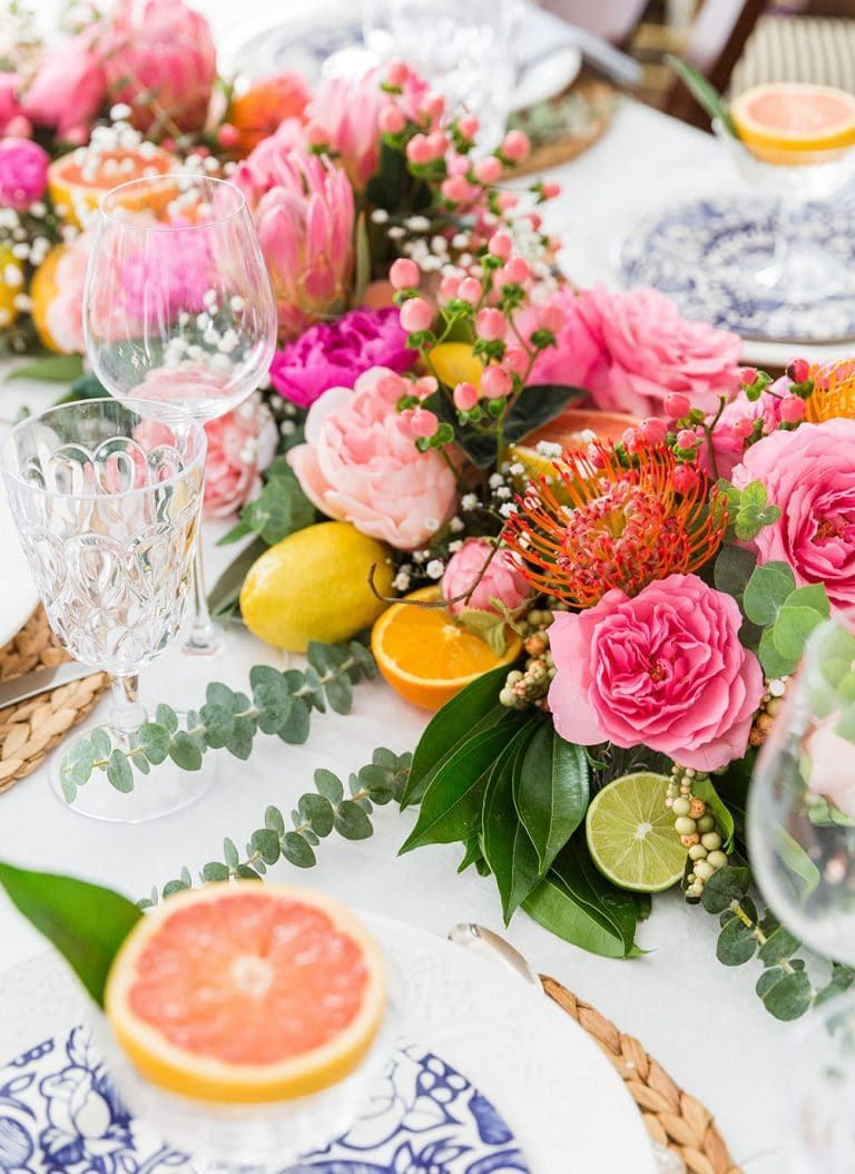 Make A Centerpiece Runner Out Of Flowers And Fruit Cheap Wedding Table Centerpieces Spring Table Decor Fruit Centerpieces