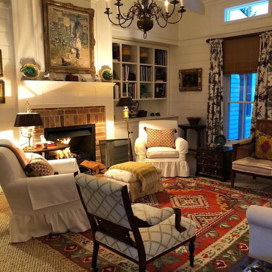 A Beautiful Living Room With Antiques Built In Bookshelves