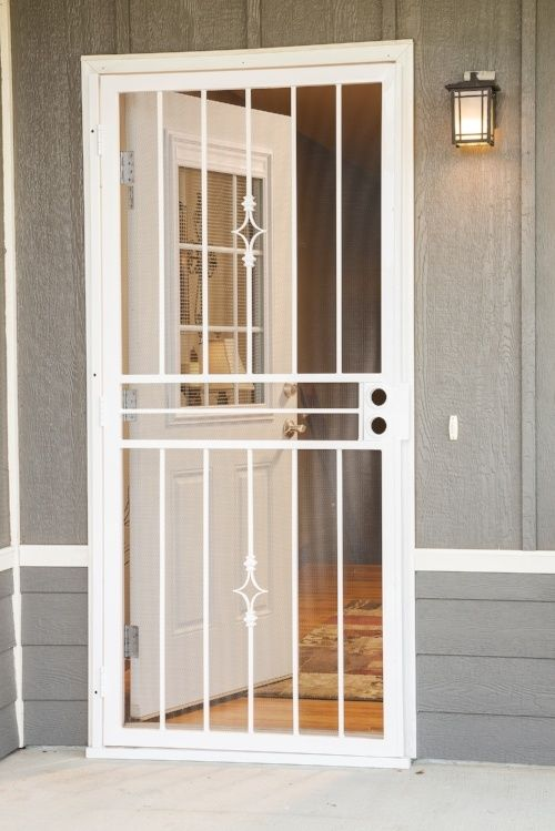 The Midview White Storm Door Adds Traditional Detailing To