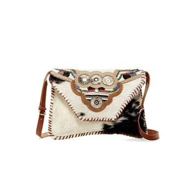 Ricki Designs Special Handbags. It is made out of Genuine Goat Hide Leather with Goat hair. It is Embellished with Metal, bead work, and leather embroidery. Adjustable Leather Handle. A REFINED COUNTRY STYLE LOOK.@ Signaturethings.com  #Bags #leather #HandBag #purse #LeatherBags #NewArrivals #Gifts #GiftsIdeas #ShopOnline  #Gifts     #GiftsIdeas  #Shoulderbag #CrossBody
