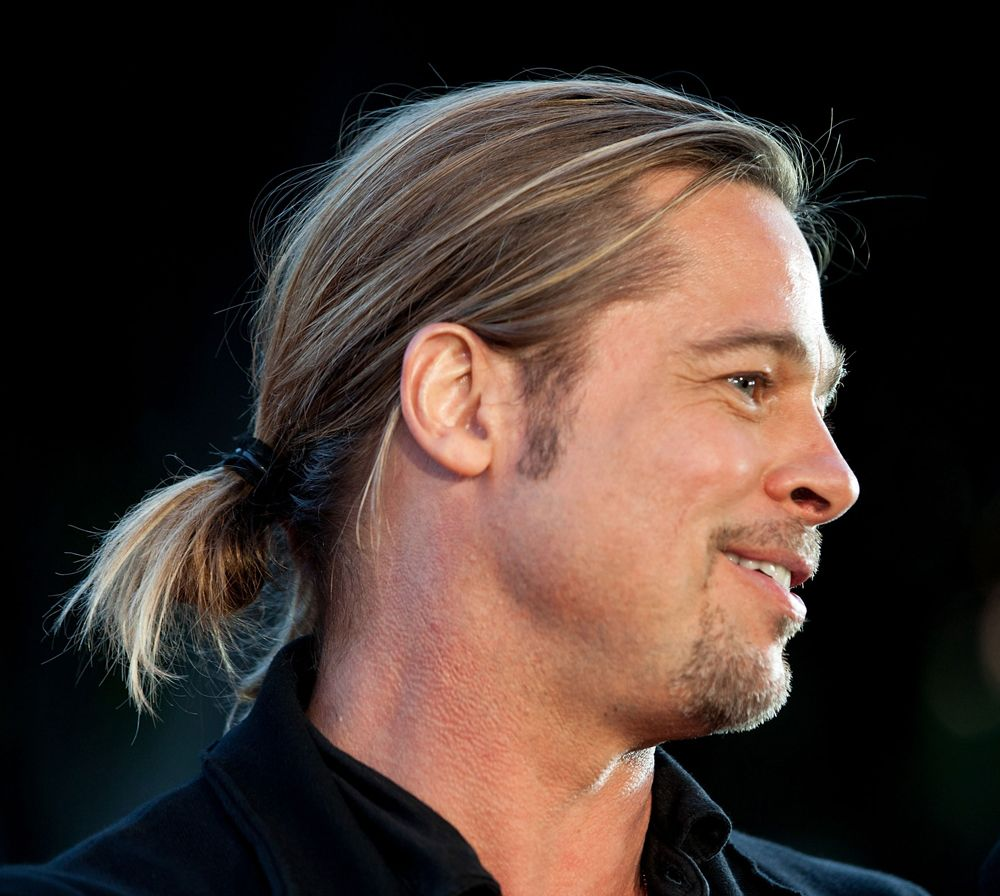 brad pitt's casual ponytail he wore to the world war z premiere is