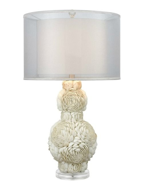 In a glamorous shape, this 30 inch tall Portonovo White Shell Table Lamp will provide a lovely glow in any room, giving it an extra sense of seaside living!