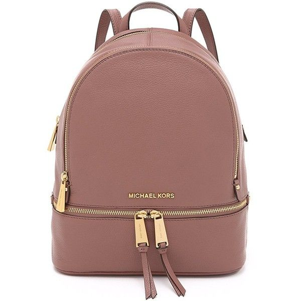 A structured MICHAEL Michael Kors backpack in pebbled leather. Polished  logo lettering accents the front. Wraparound top zip and