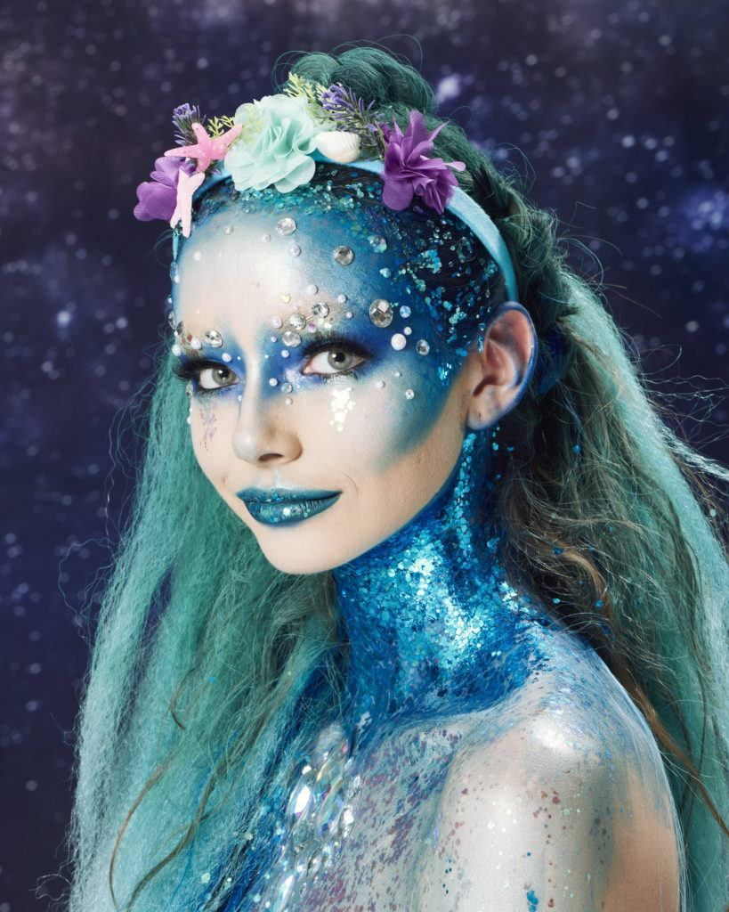 Halloween Hairstyles Woman Dressed As A Mermaid With Long Blue Hair And Unicorn Braid And Floral Headban Halloween Hair Mermaid Makeup Halloween Mermaid Hair