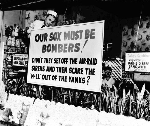 White Sox fanfare, 1959  ( Tribune photo by Luigi Mendicino )  Fire commissioner Robert Quinn ordered a celebratory five-minute sounding of Chicago's air-raid sirens after the White Sox won the pennant in 1959. The sirens may have scared many Chicagoans, but they did not dampen the enthusiasm of this Loop restaurant owner for his favorite team.