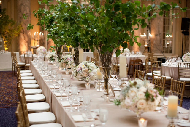 A Garden Feel In An Indoor Venue By Using Tall Arrangements Of Tree Branches And Small