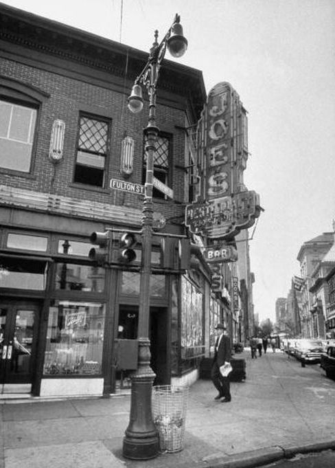 Joe's Bar, Fulton Street, but I think the lamp post, street sign, and traffic light steal the shot. (Photo by Walter Sanders//Time Life…