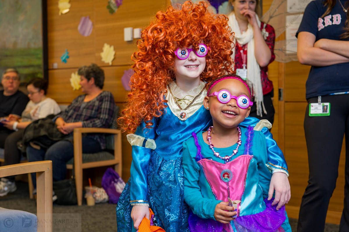 Two Jimmy Fund Clinic patients try on some #Halloween glasses at the clinic's trick-or-treat event.