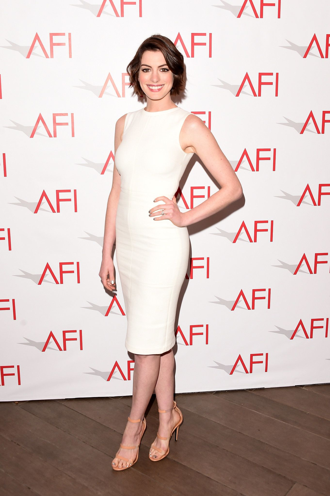 Anne Hathaway in a curve-skimming white dress.