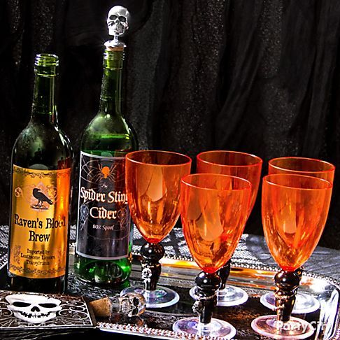 Shocktails! Creepy & classic Halloween cocktails - Party City  Get wickedly charming with wine charms and bottle stoppers featuring scary skulls. Disguise your wine bottles with Halloween Bottle Labels to really thrill scream-seeking guests. Blood Manor Wine Goblets and skull napkins pair perfectly with this look that's frightfully fit for a bone collector's boo bash.