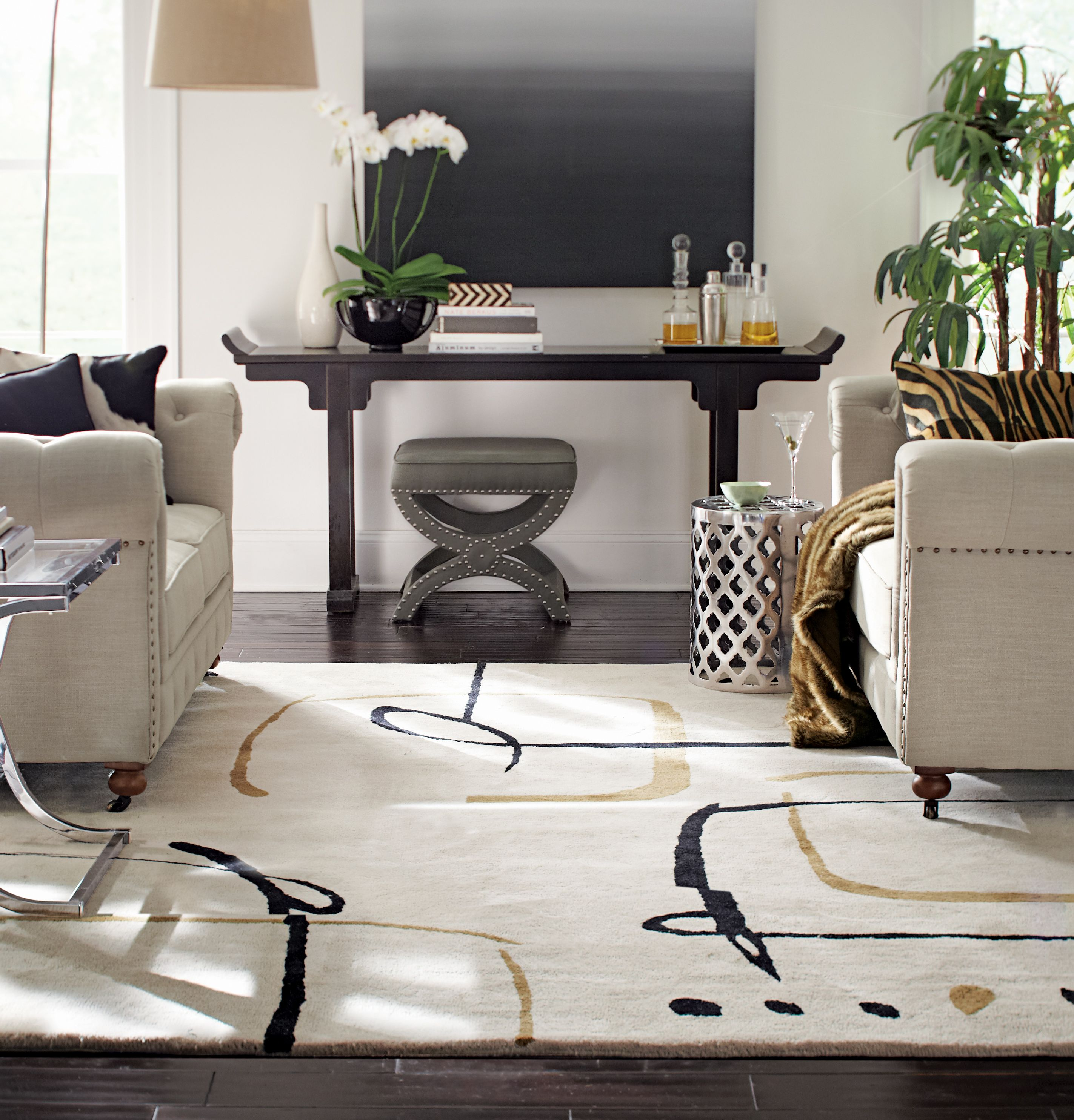 A contemporary rug that ties the whole room together. HomeDecorators ...