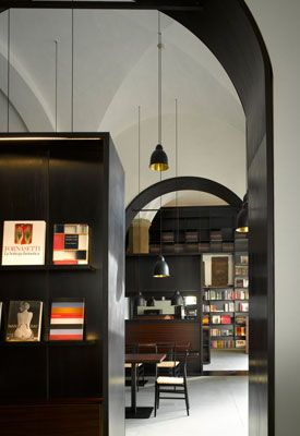 1ec6f07e9369 The Gucci Museo is a sophisticated library space with beautiful dark  joinery and stunning lighting. architect: Frida Giannini