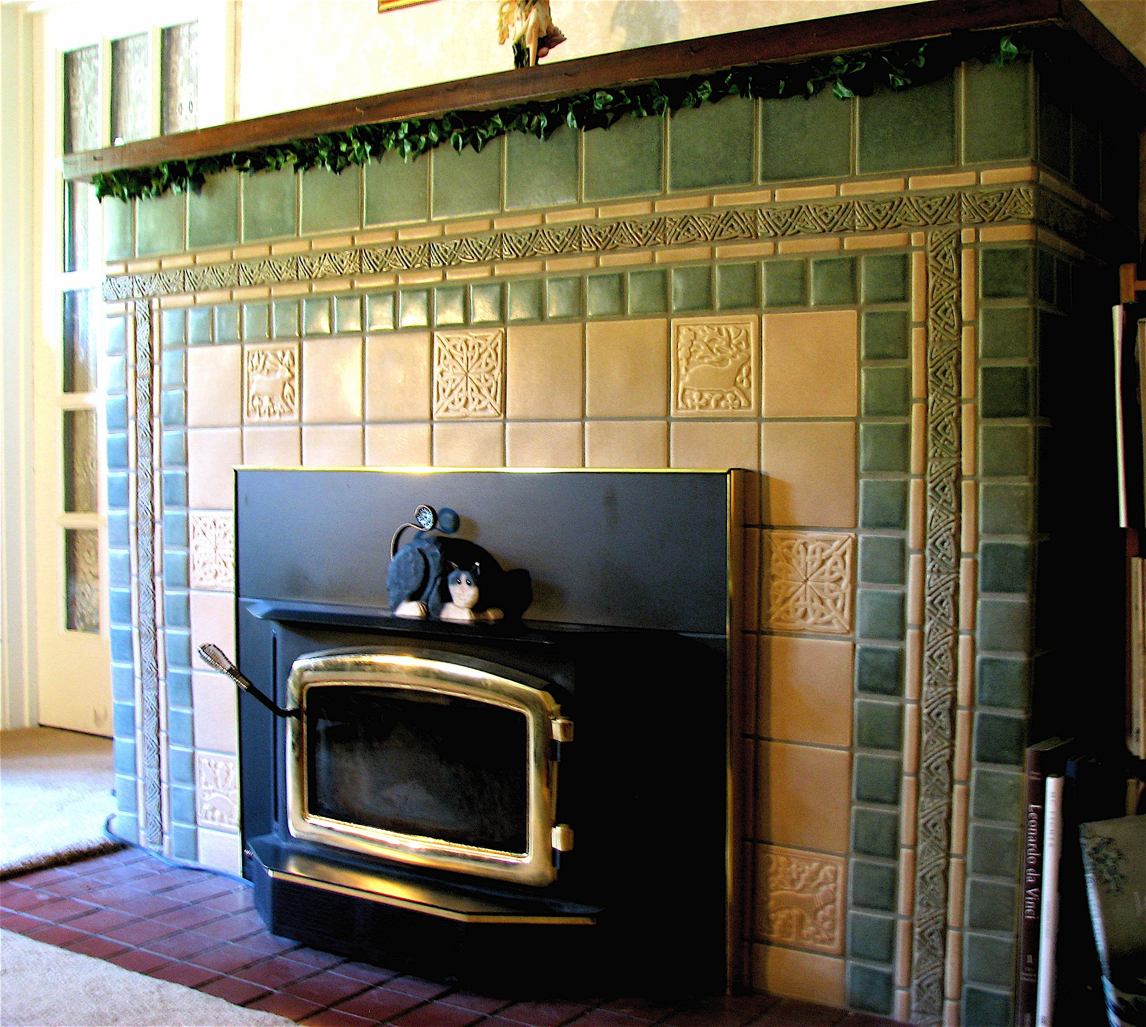 Fireplace featuring Motawi Medieval Animals and Celtic border ...