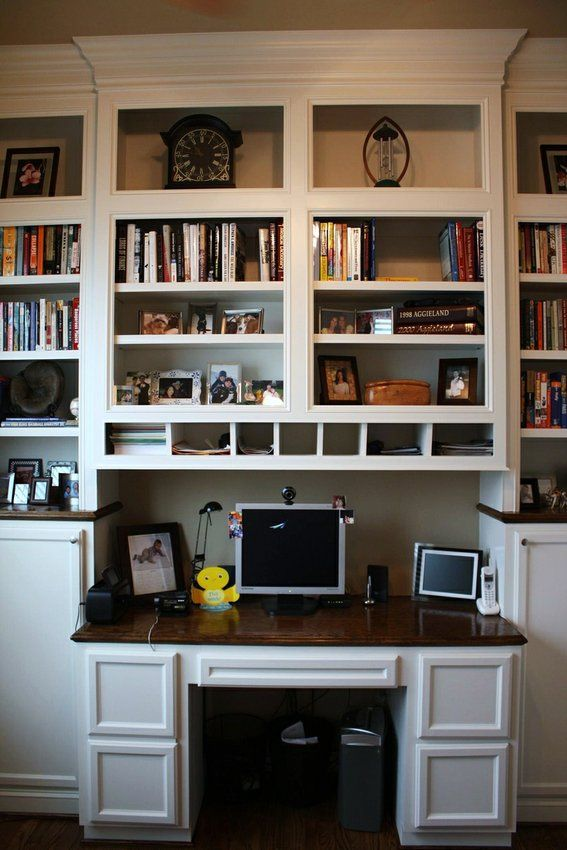 built in bookshelves with built-in desk that protrudes out a bit. For phase