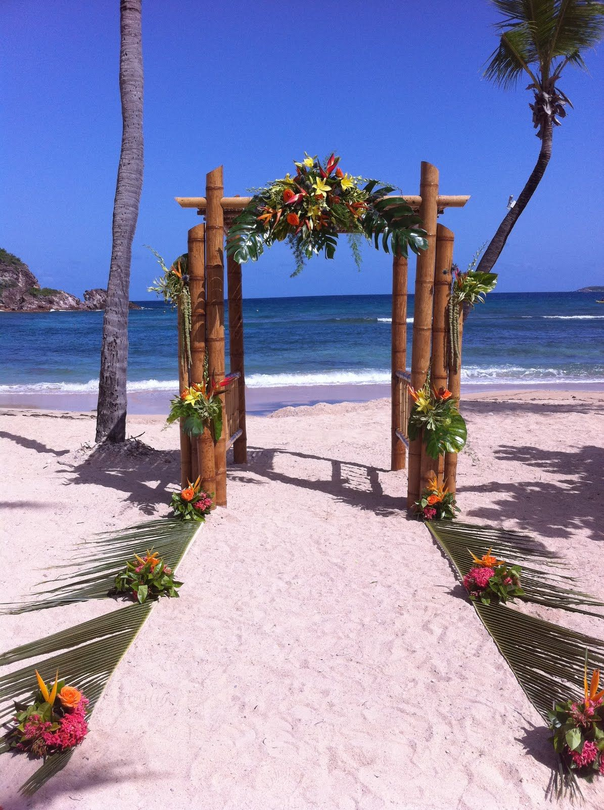 beach wedding ideas, authentic beach wedding, bamboo arch covered