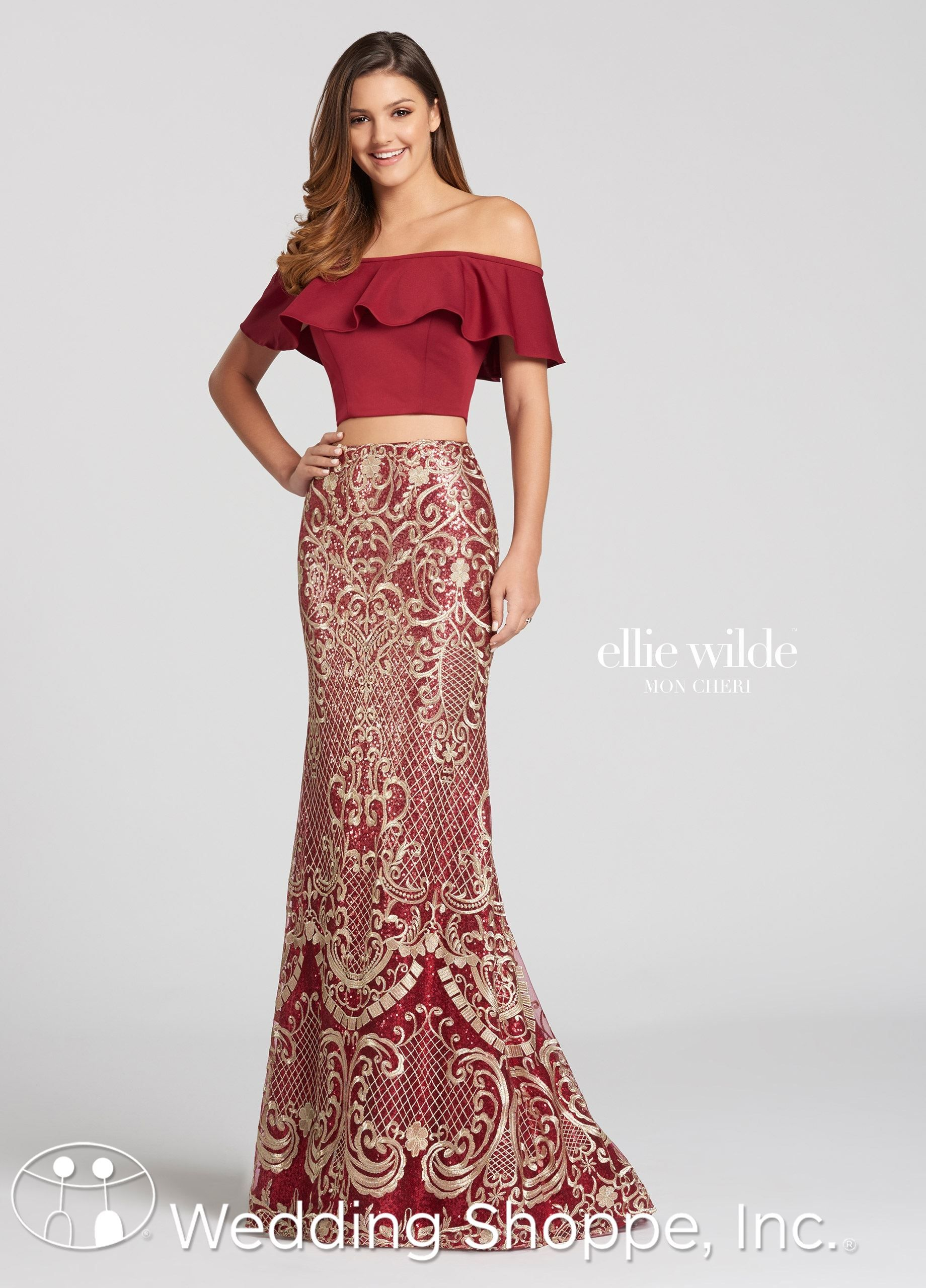 633f1037d263f7 A beautiful and unique two piece sheath prom dress with an off the shoulder  top and high waisted patterned skirt. Available in wine gold